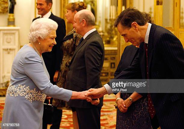 Queen Elizabeth II greets General Sir John McColl Lieutenant Governor of Jersey during a reception for Lieutenant Governors at Buckingham Palace on...