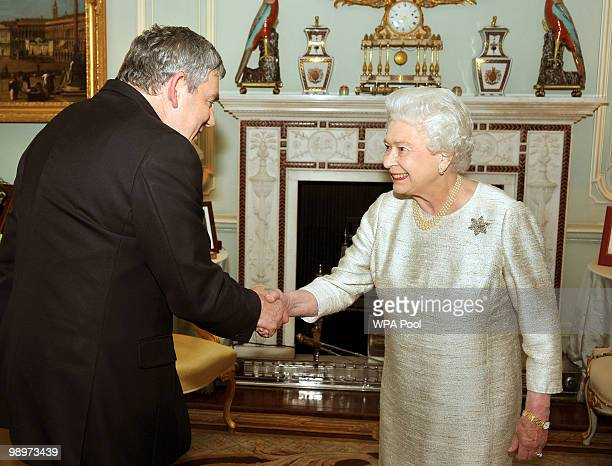 Queen Elizabeth II greets Gordon Brown at Buckingham Palace for an audience at which he tendered his resignation as Prime Minister on May 11 2010 in...