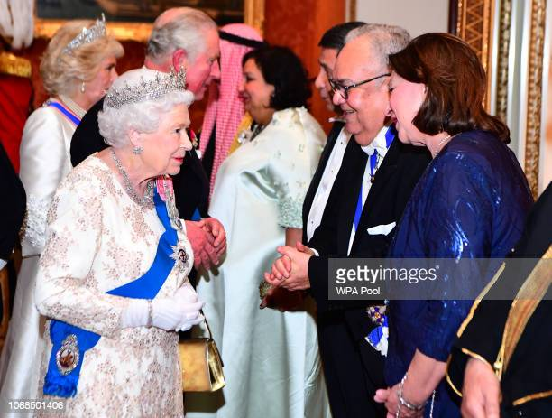 Queen Elizabeth II greets greets the ambassador of Honduras at an evening reception for members of the Diplomatic Corps at Buckingham Palace on...