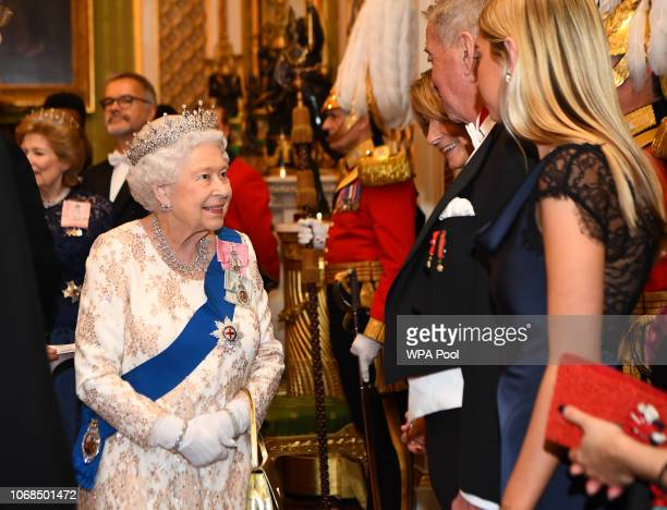 Queen Elizabeth II greets greets the family of the ambassador of Norway at an evening reception for members of the Diplomatic Corps at Buckingham...