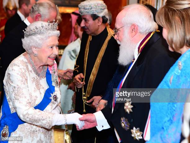 Queen Elizabeth II greets guests at an evening reception for members of the Diplomatic Corps at Buckingham Palace on December 04 2018 in London...
