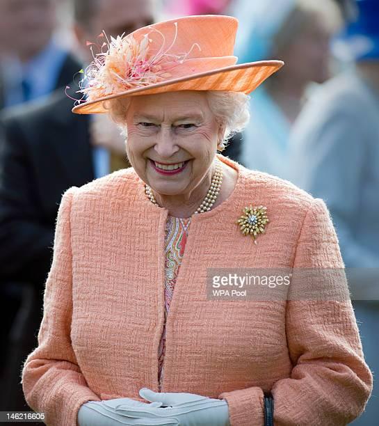 Queen Elizabeth II greets guests during a garden party in honour of her Diamond Jubilee at the Queen's Sandringham Estate on June 12, 2012 in...