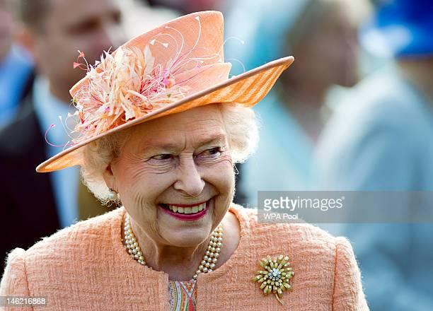 Queen Elizabeth II greets guests during a garden party in honour of her Diamond Jubilee at the Queen's Sandringham Estate on June 12 2012 in Norfolk...