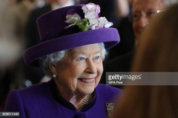 Queen Elizabeth II greets guests during a visit to the International Maritime Organization to mark the 70th anniversary of its formation on March 6...