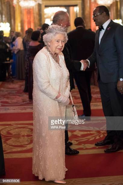 Queen Elizabeth II greets guests in the Blue Drawing Room in the Blue Drawing Room at The Queen's Dinner during the Commonwealth Heads of Government...