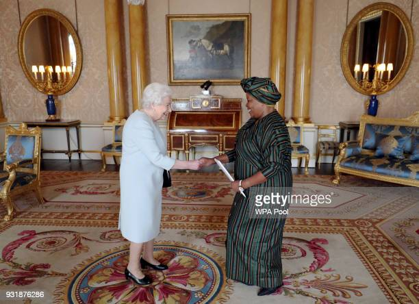 Queen Elizabeth II greets Her Excellency Susana de la PuenteWiese Ambassador of the Republic of Peru as she is presented with her credentials during...