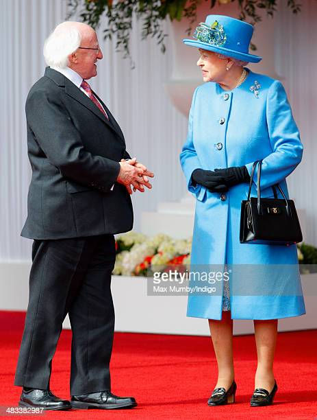 Queen Elizabeth II greets Irish President Michael D Higgins during his ceremonial welcome on April 8 2014 in Windsor England This is the first...
