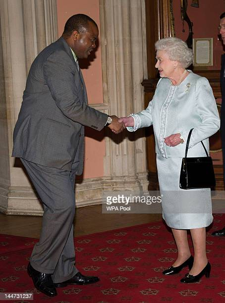 Queen Elizabeth II greets King Mswati III of Swaziland as he arrives at a lunch for Sovereign Monarch's held in honour of Queen Elizabeth II's...