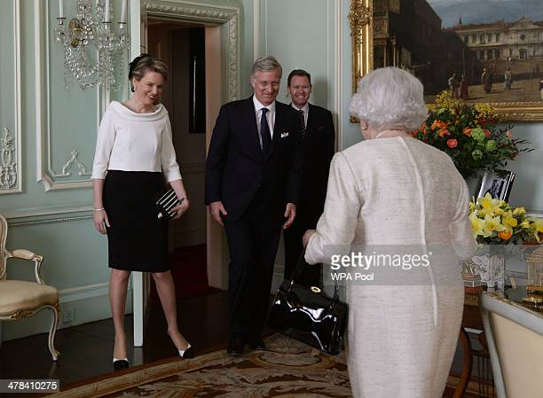 Queen Elizabeth II greets King Philippe and Queen Mathilde of Belgium at Buckingham Palace on March 13 2014 in London England King Philippe and Queen...