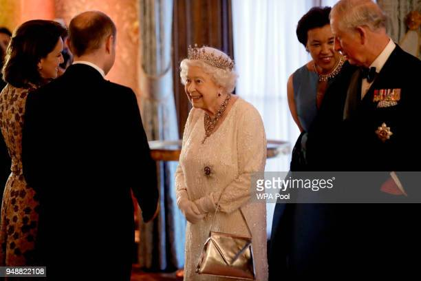Queen Elizabeth II greets Malta's Prime Minister Joseph Muscat and his wife Michelle flanked by Prince Charles, Prince of Wales in a receiving line...