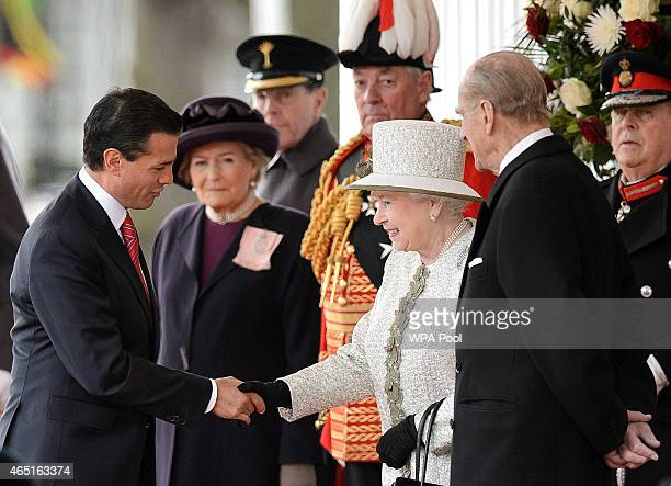 Queen Elizabeth II greets Mexican President Enrique Pena Nieto during a Ceremonial Welcome at Horse Guards Parade on March 3 2015 in London England...