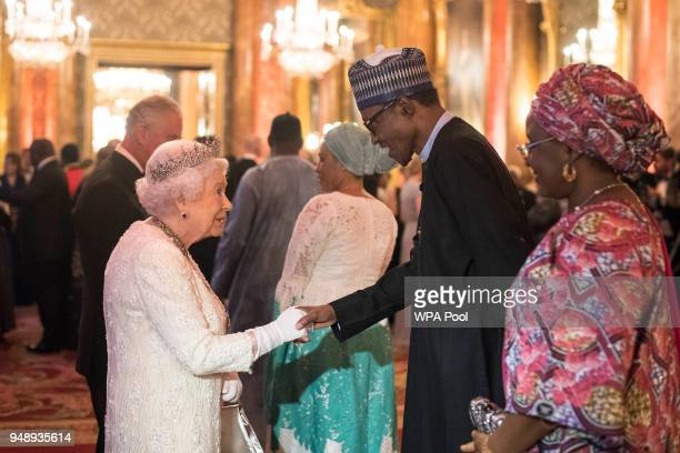 Queen Elizabeth II greets Muhammadu Buhari President of Nigeria in the Blue Drawing Room in the Blue Drawing Room at The Queen's Dinner during the...