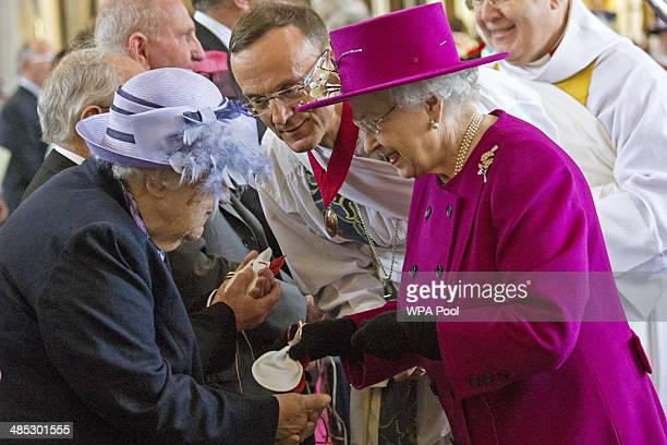 Queen Elizabeth II greets parishioners as she leaves Blackburn Cathedral after attending the Royal Maundy Service on April 17 2014 in Blackburn...