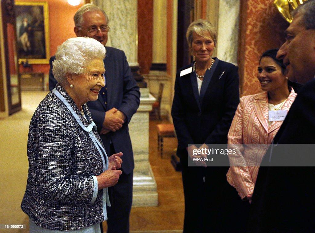 Queen Elizabeth II greets Peter Bottomley and Virginia