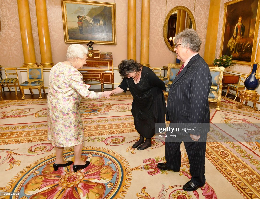 Queen Elizabeth II greets Poet Laureate Carol Ann Duffy (C) before she presented Paul Muldoon (R) with the Queen's Gold Medal for poetry, during a private audience at Buckingham Palace on May 15, 2018 in London, England.
