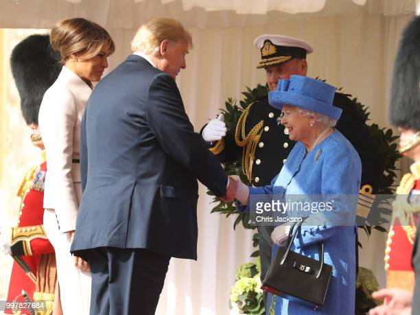 Queen Elizabeth II greets President of the United States Donald Trump and First Lady Melania Trump at Windsor Castle on July 13 2018 in Windsor...