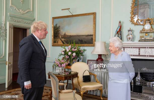 Queen Elizabeth II greets Prime Minister Boris Johnson during the first in-person weekly audience with the Prime Minister since the start of the...