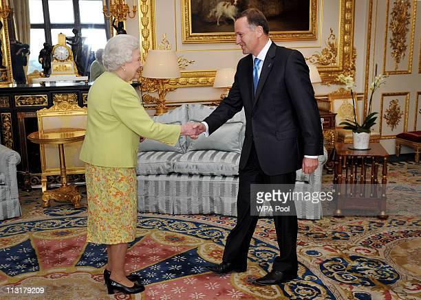 Queen Elizabeth II greets Prime Minister of New Zealand John Key in the White Room at Windsor Castle in Windsor United Kingdom