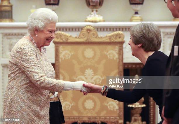 Queen Elizabeth II greets Prime Minister Theresa May at a reception to celebrate the Commonwealth Diaspora community in the lead up to the...