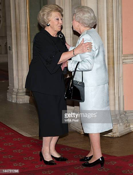 Queen Elizabeth II greets Queen Beatrix of Holland as she arrives at a lunch for Sovereign Monarch's held in honour of Queen Elizabeth II's Diamond...