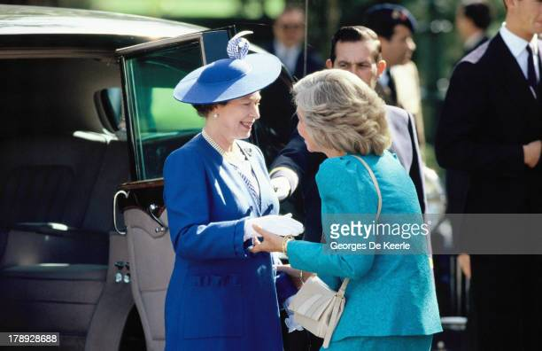 Queen Elizabeth II greets Queen Sofia of Spain during a state visit to Spain on October 17 1988 in Madrid Spain