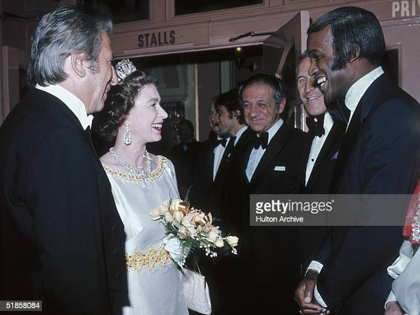 Queen Elizabeth II greets singer Lovelace Watkins backstage at the Royal Variety Show 15th November 1971 Bruce Forsythe and Sid James look on