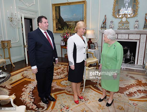 Queen Elizabeth II greets the President of Croatia Kolinda GrabarKitarovic and her husband Jakov at the start of a private audience at Buckingham...