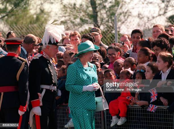 Queen Elizabeth II greets wellwishers on her arrival at Bermuda Airport accompanied by the island's Governor Lord Waddington the former Conservative...