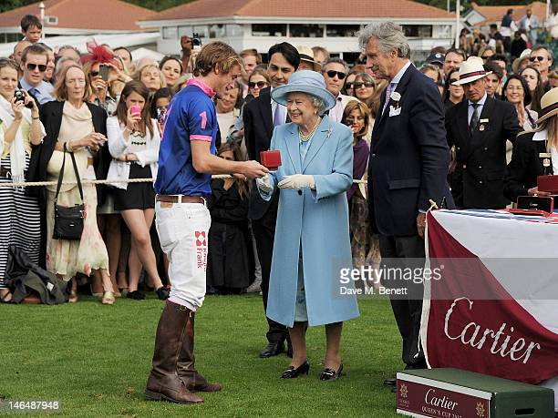 Queen Elizabeth II hand out prizes to players with Cartier Managing Director Francois Le Troquer and Executive Chairman of Cartier UK Arnaud...