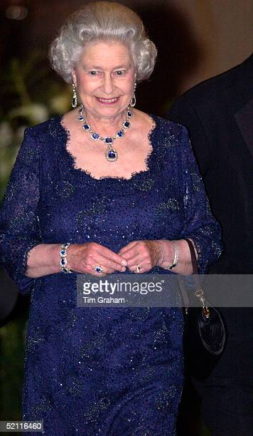 Queen Elizabeth II Happy And Smiling As She Leaves The Ritz Hotel After A Party To Celebrate Her Golden Jubilee Year She Wore A Suite Of Sapphire And...
