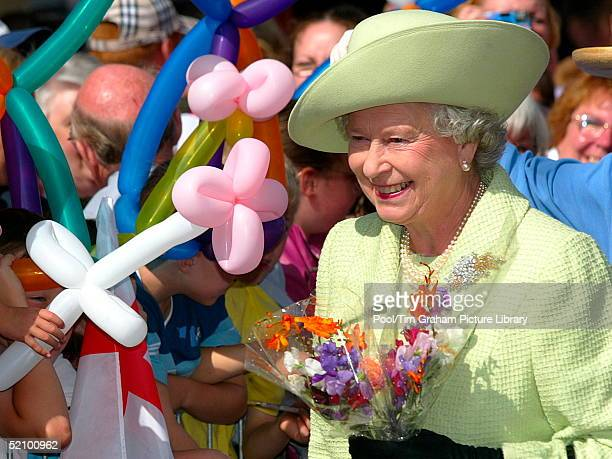 Queen Elizabeth II Happy And Smiling During A Walkabout In The Centre Of Preston