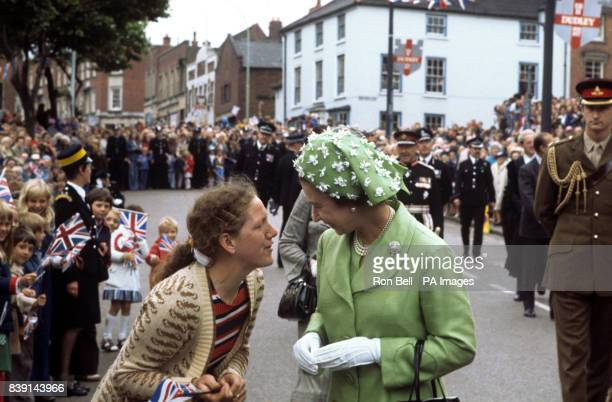 Queen Elizabeth II has a chat whilst on a walkabout in Dudley during her Silver Jubilee Tour of Britain