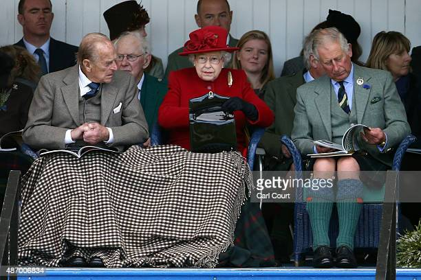 Queen Elizabeth II her husband Prince Philip and Prince Charles watch competitors at the Braemar Gathering on September 5 2015 in Braemar Scotland...