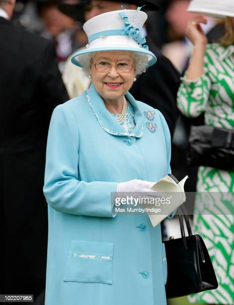 HM Queen Elizabeth II holds a race card as she watches the horses in the parade ring on day four of Royal Ascot at Ascot Racecourse on June 18 2010...