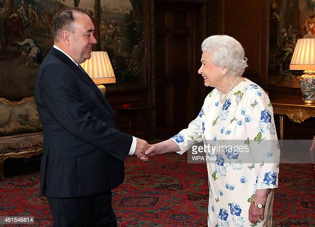 Queen Elizabeth II holds an audience with Scotland's First Minister Alex Salmond at the Palace of Holyroodhouse on July 1 2014 in Edinburgh Scotland