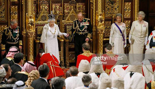 Queen Elizabeth II holds hands with Prince Philip Duke of Edinburgh after delivering the Queen's Speech to the House of Lords in the Palace of...