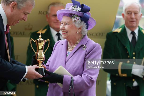 Queen Elizabeth II holds the Gold Cup and Prince Andrew Duke of York after Ryan Moore riding Estimate won The Gold Cup during Ladies' Day on day...