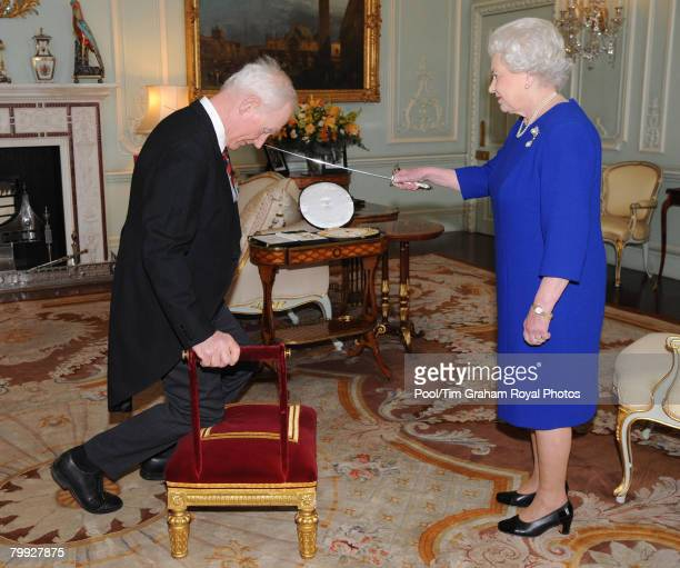 Queen Elizabeth II honours Sir Garth Morrison with a Knighthood and invests him with the insignia of a Knight of the Thistle at Buckingham Palace on...