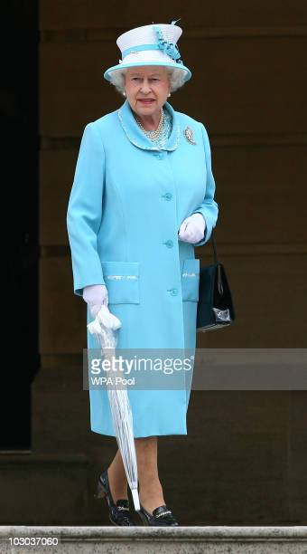 Queen Elizabeth II hosts a garden party in the gardens of Buckingham Palace on July 22 2010 in London England At least three garden parties are...