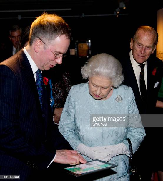 Queen Elizabeth II II and Prince Philip Duke of Edinburgh are shown an exhibition iPad app by Dr Scot McKendrick Curator of History and Classics at...