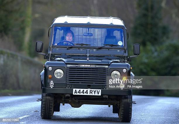 Queen Elizabeth II in a Land Rover Defender 110 as she drives herself to the stables on the Sandringham Estate Norfolk