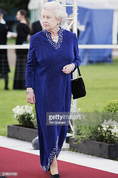 Queen Elizabeth II in caftan style dress with slit front arrives for a party/dinner at the Royal Windsor Horse Show on May 12 2006 in Windsor England