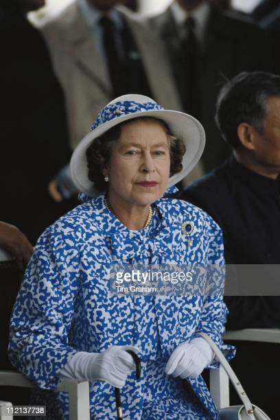 Queen Elizabeth II in Canton during an official State Visit to China October 1986 The Queen is wearing a blue and white dress with matching hat