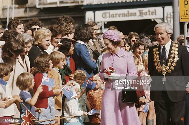 Queen Elizabeth II in Christchurch during her visit to New Zealand 1977 She is accompanied by Sir Hamish Hay Mayor of Christchurch In the background...