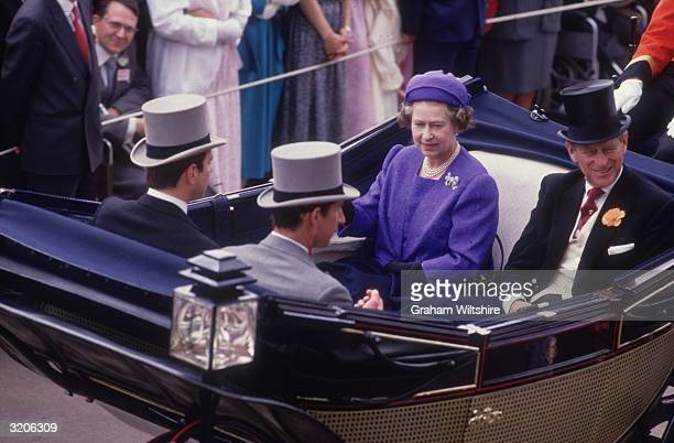 Queen Elizabeth II in her carriage at Ascot races with husband Prince Philip, Duke of Edinburgh. Her sons Prince Charles, Prince of Wales and Prince...