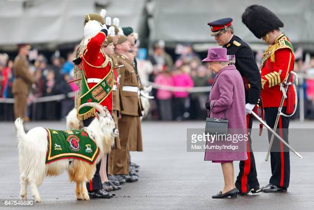 Queen Elizabeth II, in her role as Colonel-In-Chief of The Royal Welsh, attends a review and presentation of leeks to soldiers of The Royal Welsh to...