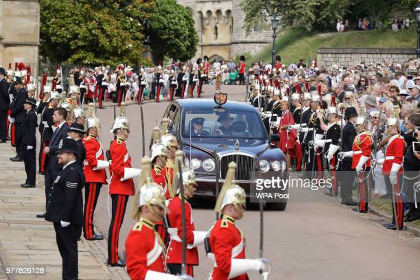 Queen Elizabeth II in her role as Sovereign of the Garter is driven to the Order of The Garter Service at Windsor Castle on June 18 2018 in Windsor...