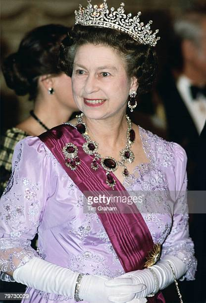 Queen Elizabeth II in Portugal wears a necklace and brooch of amethyst jewels which originally belonged to Queen Victoria's mother The tiara known as...