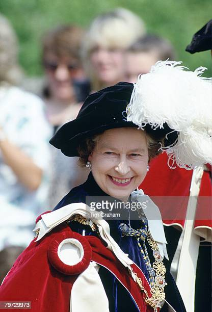 Queen Elizabeth II in robes and plumed hat in the Garter Ceremony procession at Windsor Castle