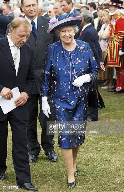 Queen Elizabeth II in the grounds of Buckingham Palace for a garden party to mark 50 years of the Duke of Edinburgh's award scheme on July 13 2006 in...